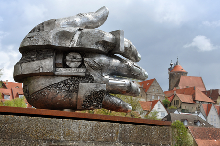 metal sculpture: Besigheim, Germany - April 24, 2016: Modern metal sculpture in the form of a huge hand on the background of historical sites of Besigheim. Baden-Wurttemberg, Germany.