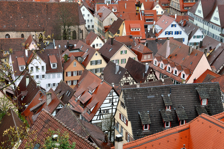Panorama of Tubingen, Baden-Wurttemberg, Germany. Lots of half-timbered houses with red tiled roofs in perspective.