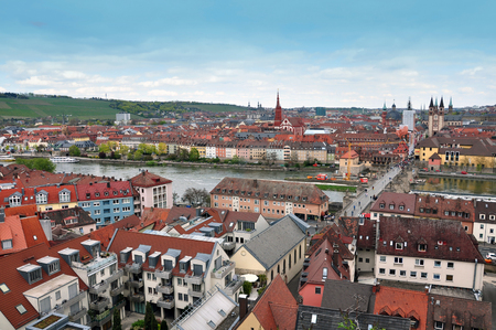 Wurzburg, Germany - April 18, 2016: Panorama of Wurzburg old town, Bavaria, Germany. Red roofs, church towers along the river.