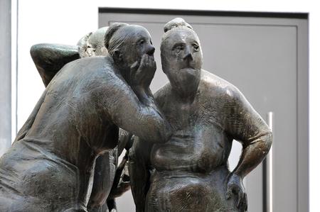 Bietigheim, Germany - April 19, 2016: Modern urban art in Bietigheim, Baden-Wurttemberg. Metal sculpture of gossiping women. Editorial