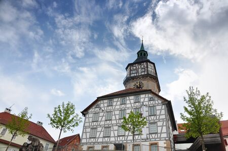 BACKNANG, GERMANY - APRIL 22, 2016: Looking up at an old half-timbered church in the background of blue sky. Backnang, Baden-Wurttemberg, Germany. Editorial