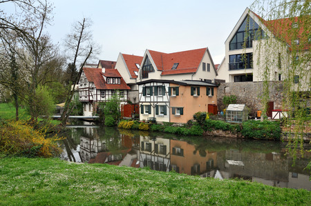 Waiblingen, Germany - April 16, 2016: Modern residential half-timbered houses along the water channel. Baden-Wurttemberg, Germany.