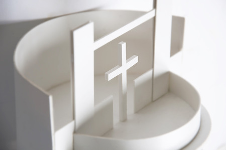 Abstract architectural white background. Model of nonexistent contemporary round church close up, selective focus.