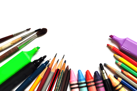 A set of color tools for drawing on a white background close up: markers, crayons, paints, pencils. Space for text.