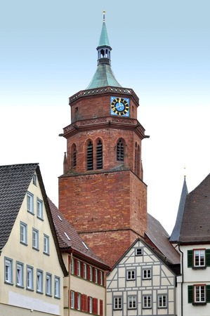 Red brick tower on the old square Weil der Stadt. Baden-Wurttemberg, Germany. Vertical view.