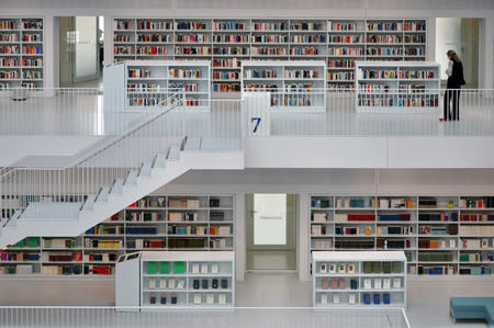 architectural studies: STUTTGART, GERMANY - APRIL 16, 2015: White interior of a modern city library. The floors of books connected by a staircase. Stadtbibliothek, Stuttgart, Germany on April  2015.