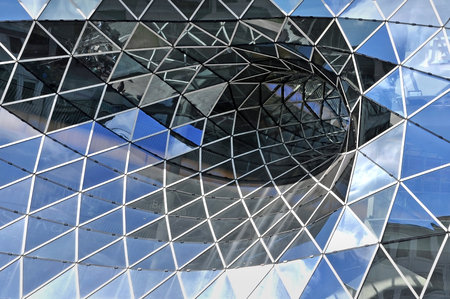 distort: Frankfurt, Germany - April 18, 2015. Glass facade of futuristic shopping center in Frankfurt am Main, Germany. Architect Massimiliano Fuksas. Editorial