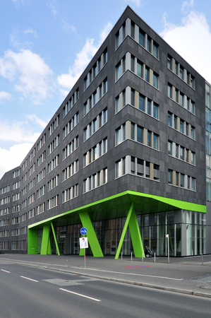 HEIDELBERG, GERMANY - APRIL 20, 2014: Angle of modern gray building with a sloping green columns in the ground floor level. Baden-Wurttemberg.
