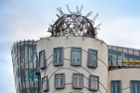 PRAGUE, CZECH REPUBLIC - APRIL 13, 2016: Fragment of the facade of the Dancing House in Prague, the architects are Frank Gehry and Vlado Milunic. The metal structure ball on the roof.
