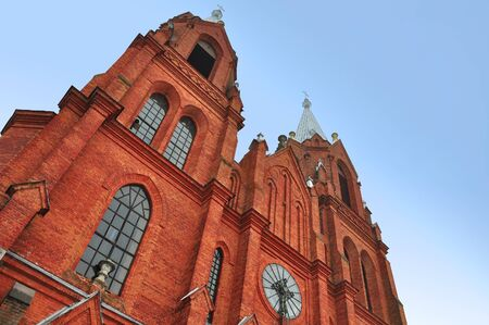 Gothic Church of the Holy Apostles Peter and Paul of red brick in the village Old Vasilishki, Grodno region, Belarus. Look up.
