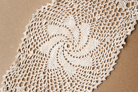 Knitted Homemade White Lace Doily With A Star Pattern On Cardboard