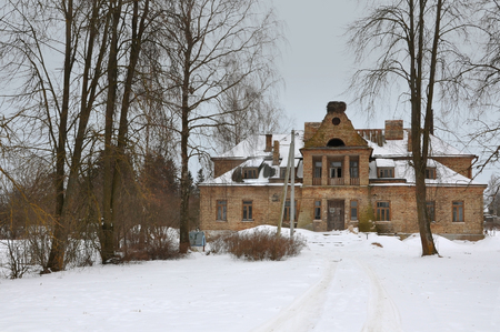Old yellow brick administration house in the Polish style in Loiki village, Grodno region, Belarus in winter. Stock Photo