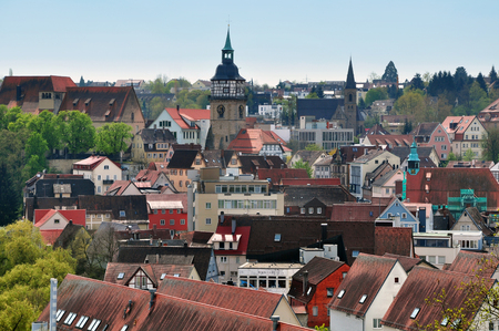 Landmarks of Backnang, Baden-Wurttemberg, Germany. Panoramic view of half-timbered houses with red tiled roofs and a church. Stock Photo