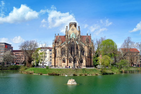 johannes: Gothic Johannes church in Stuttgart near the lake on a sunny day. Germany.