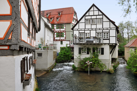 Ancient half-timbered buildings in the fishermens quarter in Ulm, Baden-Wurttemberg, Germany. House standing on the water channel. Stock Photo