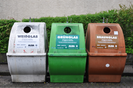 Waiblingen, Germany - April 17, 2017: Three garbage containers for collecting white, green and brown glass.