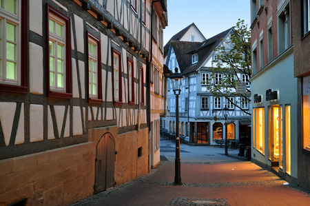 Backnang, Baden-Wurttemberg, Germany - April 24, 2017: Ancient street of Backnang with half-timbered houses in the evening.