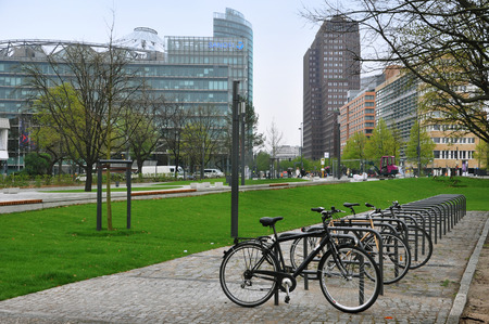 Berlin, Germany - April 12, 2017: Many parked bicycles in the background of the skyscrapers of the business center in Berlin. Editorial