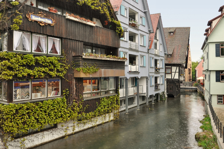 Ulm, Baden-Wurttemberg, Germany - April 25, 2017: Ancient half-timbered houses with green ivy in the fishermens quarter in Ulm.