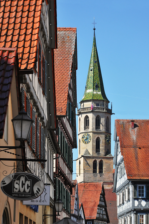 Schorndorf, Baden-Wurttemberg, Germany - April 21, 2017: Tower of the city church and historical houses in the foreground in Schorndorf. Vertical view.