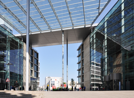 Stuttgart, Germany - April 21, 2017: Modern business center in Stuttgart. Glass buildings and transparent canopy with columns. Editorial