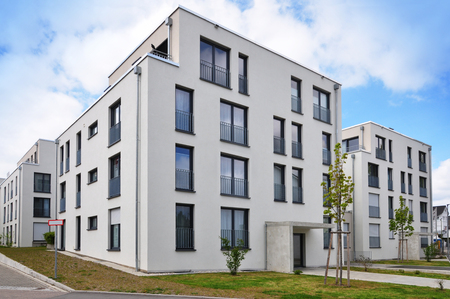 Leonberg, Baden-Wurttemberg, Germany - April 23, 2017: Modern white residential elite low-rise houses with terraces and wide window Editorial