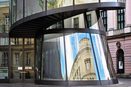 Berlin, Germany - April 13, 2017: German Historical Museum in Berlin. Curve glass reflected old building. Editorial