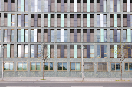 Berlin, Germany - April 14, 2017: Front facade of modern building of different colored vertical panels. Editorial