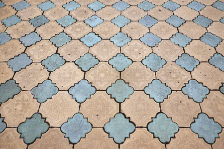 Texture of the old patterned tile pavement.