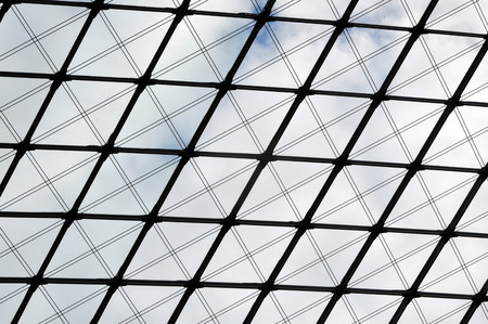Architectural background. Glass ceiling of metal frame and planar glazing. Look up. Lizenzfreie Bilder