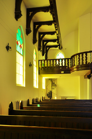 Interior of the Lutheran Church in Grodno, Belarus in yellow light. Lizenzfreie Bilder