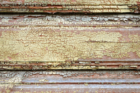 Texture of wooden boards with an old cracked paint. Grunge background, empty space. Lizenzfreie Bilder