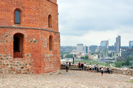 Fragment of the ancient Gedimin tower against the downtown of Vilnius.