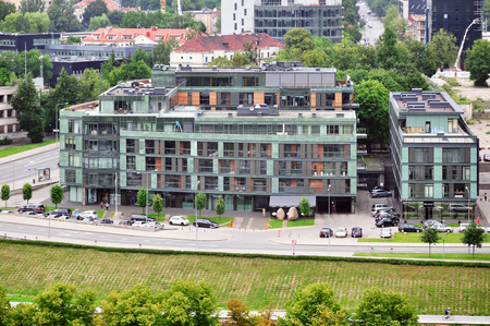 Modern multistory building of gray and green panels. Vilnius Panorama.