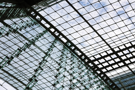 Berlin Railway Station building. Glass wall and ceiling of metal frame and planar glazing. Look up.