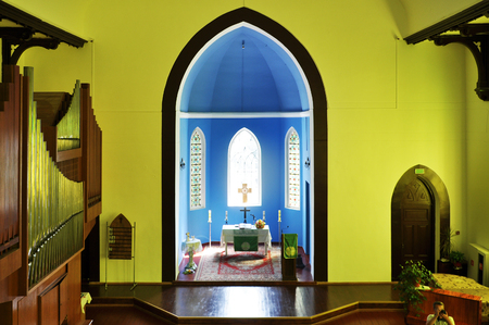 Interior of the Lutheran Church in yellow light. View of the altar. Grodno, Belarus.