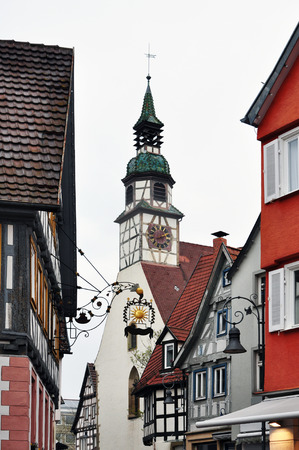 The old picturesque street of Waiblingen with colorful half-timbered houses and the city church tower. Baden-Wurttemberg, Germany.