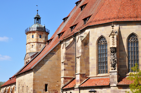 Gothic church of St. Michael. in Schwabisch Hall. View of the apse and the tower on a sunny day. Baden-Wurttemberg, Germany.