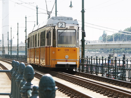 Budapest, Hungary. A yellow tram traveling along the embankment.