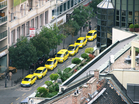 Budapest, Hungary. Many yellow taxis stand along the avenue. View from above. Editorial