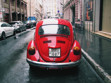 Back view of a red car on an ancient street in Budapest. Hungary Editorial