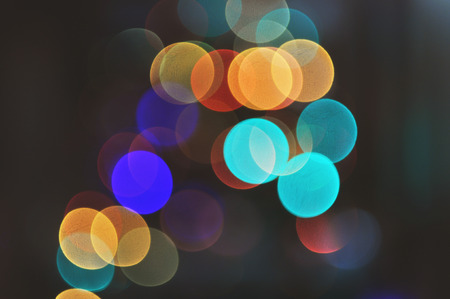 Christmas background. A lot of different multicolor lights in bokeh in the dark. Standard-Bild