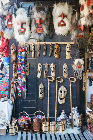 Bran, Romania - October 5, 2018: Various handmade scary masks on the souvenir market at castle.