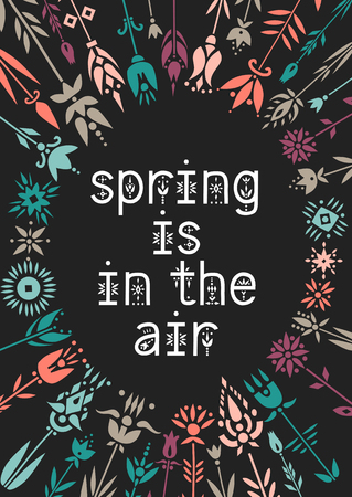 Lettering poster Spring Is In The Air inside the floral wreath on a black background.