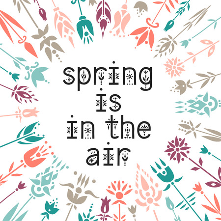 Lettering poster Spring Is In The Air inside the floral wreath.