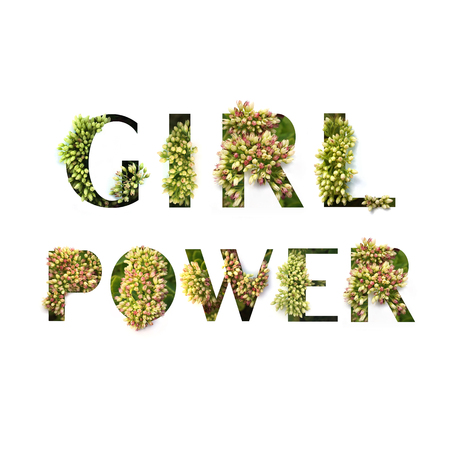 Cut out words Girl Power with growing plant inside.