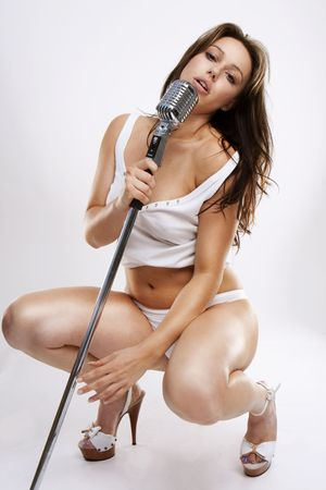 sexy glamour pop star singer with white lingerie and retro microphone Stock Photo - 4840016