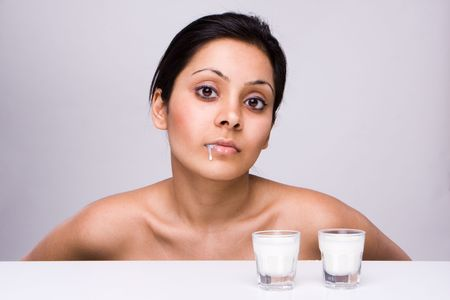 Fresh and beautiful girl  with milk dripping from her lips Stock Photo - 4840182