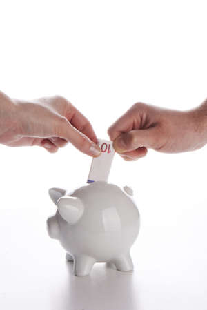 Piggy bank, couple,  hands and euro currency on white photo