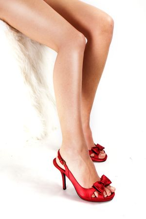 ankles sexy: Red high heels isolated against a white background